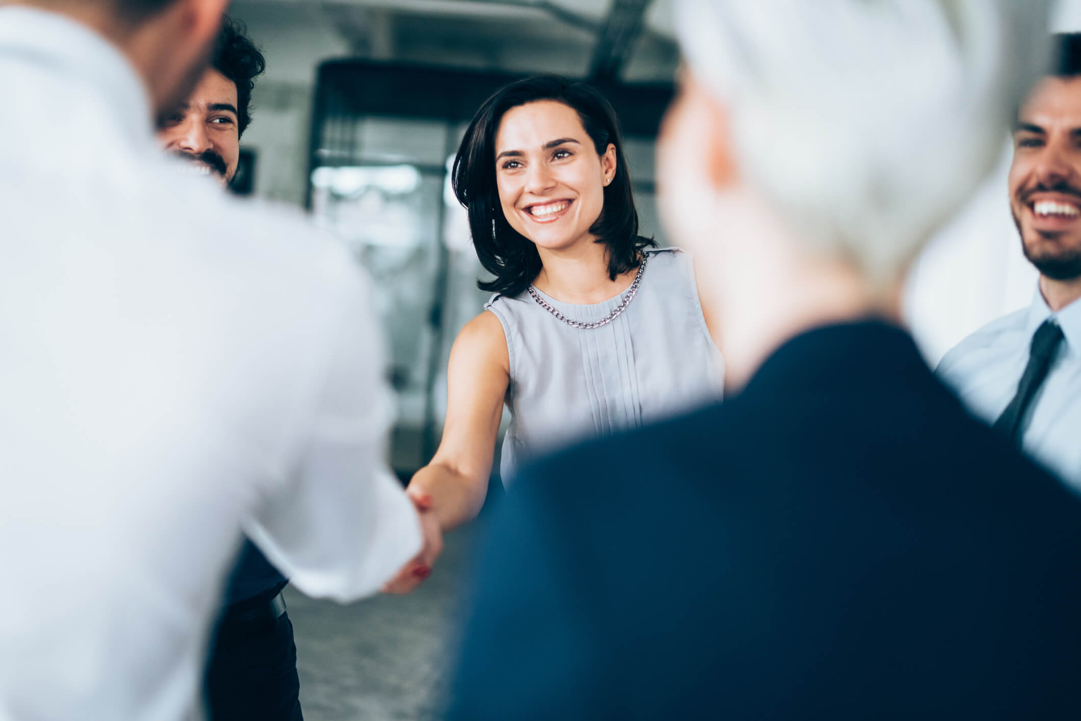 Female business person shaking hands with business associate